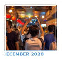 A still tourist in the centre of the Wangfujing shopping street in Beijing, often tourists stop and photograph the many smells and sights of the traditional street, getting frustrated with the sheer number of tourists around.