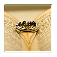 Love is in a ring, shadows cast a heart from a loving gift. Part of a private clients wedding ceremony