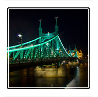 Liberty bridge connects Buda and Pest in the great city of Budapest, Hungary. The bridge features art nouveau design, mythological sculptures and the country's coat of arms adorned on its side