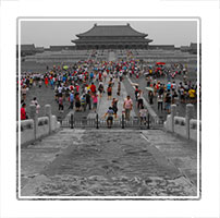 A selective colour photograph of Beijings forbidden city, highlighting the many thousands of people who attend the palace museum every day