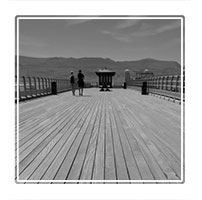 Beamaris Pier overlooking the Menai Straight on a bright sunny day, Beamaris, Anglesey, North Wales UK