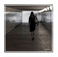 A lone woman walking home in a subway under the main streets near the Kremlin in Moscow Russia