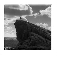 On Top, Climbers on the rocks in the Peak District National park, England, UK